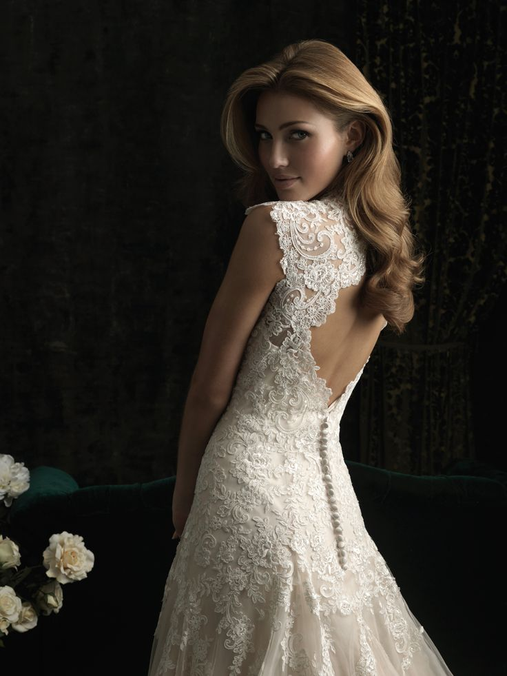 This sexy, yet sophisticated wedding gown by Allure Bridals 8965 will have everyone's eyes on you.