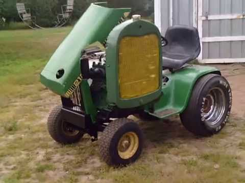 Sweet sound out of that flathead.  John Deere 212 Repower to LUC 2 cyl combine engine Done - YouTube