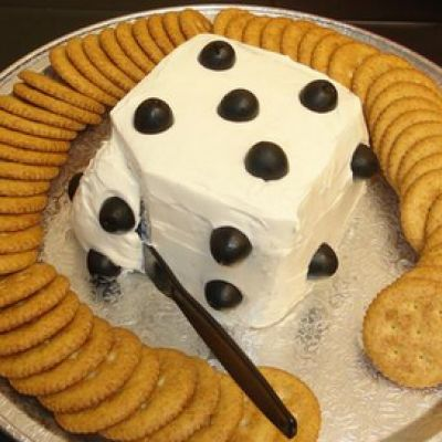 "For Bunco!  Turn your cheese ball into a cheese die! Just make it square and cut olives in half - so cute! Get even more creative and have two ""dice"" on the platter!"