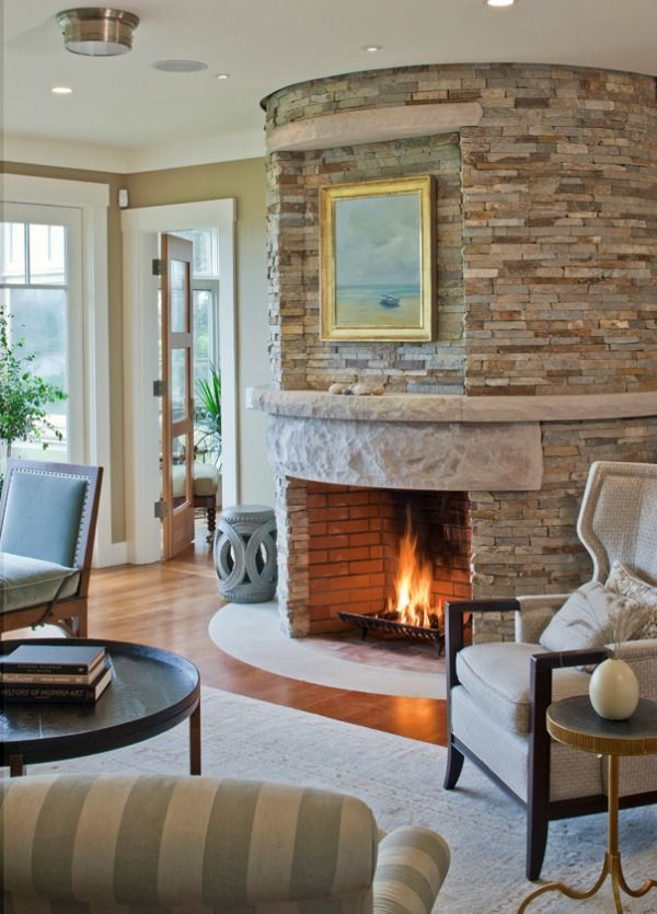 A Crackling Fire In Round Fireplace
