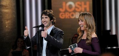 """In this photo contributed by HSN, international recording artist, Josh Groban, left, appears on stage with HSN host Diana Perkovic as he performs his new CD """"All the Echoes"""" on the HSN Live stage on Friday, Jan. 18, 2013, in St. Petersburg, Fla. (AP Photo/HSN, Brian Blanco)"""