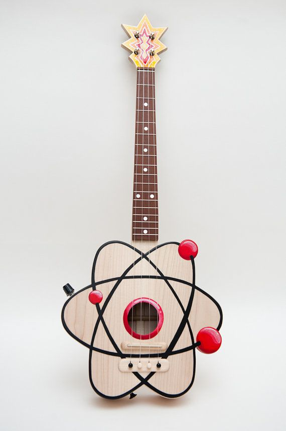 The Atom Ukulele : Paul Celentano of Etsy shop Celentano Woodworks handcrafts his maple-wood Atom Ukuleles. Each one of these beauties features the atomic symbol, are custom made-to-order by Celentano