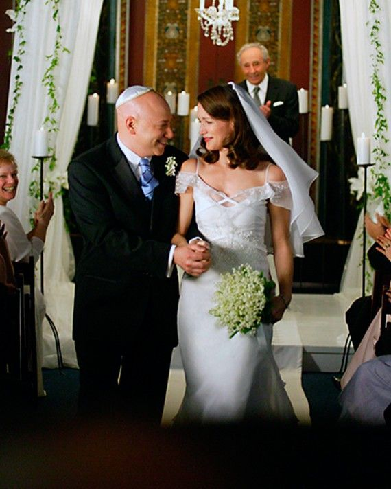 A white silk Badgley Mischka sheath with cap sleeves and a beaded bodice was Charlotte York (Kristin Davis)'s gown of choice for her second wedding to Harry Goldenblatt (Evan Handler).