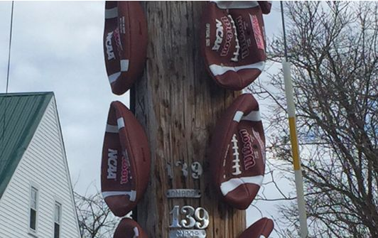 A Patriots Fan Nailed Footballs To A Telephone Pole Next To Roger Goodell's House In Maine