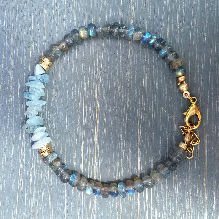 Gorgeous 'A' grade labradorite gemstone beads & ice blue aquamarine gemstone chip beads. Finished with gold filled findings, lobster clasp & ring, and chain extender.