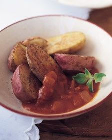 Traditionally, patatas bravas consist of fried potatoes that are sauteed in a spicy tomato sauce. Here, the sauce is served on the side, as a spicy accompaniment to flavorful roasted potatoes. Small new potatoes may also be used. Per serving: 101 calories, 2 g fat, 0 mg cholesterol, 19 g carbs, 368 mg sodium, 3 g protein, 2 g fiber