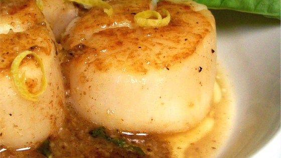 Scallops sauteed in butter and garlic will melt in your mouth. Lemon juice gives it a nice kick.