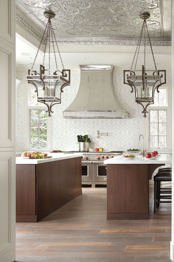 A touch too traditional for what we want, but I like the floors and mix of dark cabinets with white countertops and backsplash