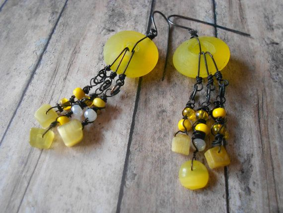 Yellow matte glass donuts with oxidized wire wrapped by NovaLeighs