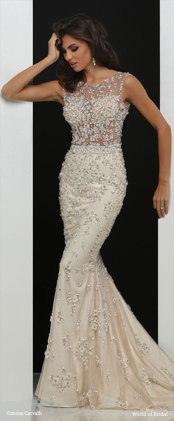 Jeweled illusion neckline sheath gown accented with handmade floral and beading.