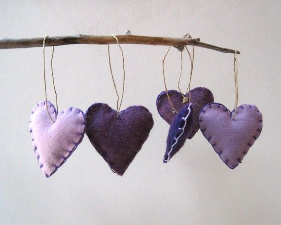 Felt hearts - could be cute to hang a branch on the wall in the nursery, then string felt hearts/stars/moons/etc. from it.