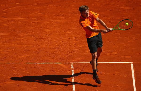 David Goffin Photos Photos - David Goffin of Belgium plays a backhand against Steve Darcis of Belgium in their first round match on day one of the Monte Carlo Rolex Masters at Monte-Carlo Sporting Club on April 16, 2017 in Monte-Carlo, Monaco. - ATP Masters Series: Monte Carlo Rolex Masters - Day One