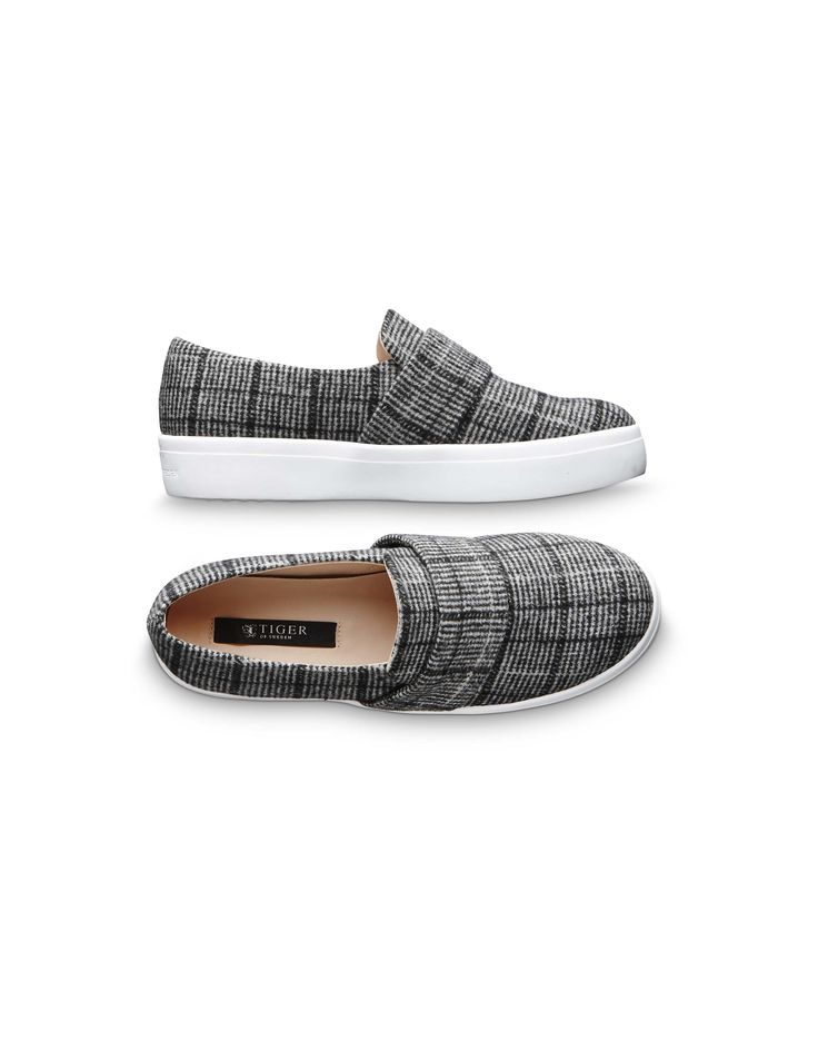 Yvonne W sneakers  Women's slip-on sneaker in woven checked fabric. Features a wide strap across front of shoe in same fabric. Rubber outsole.