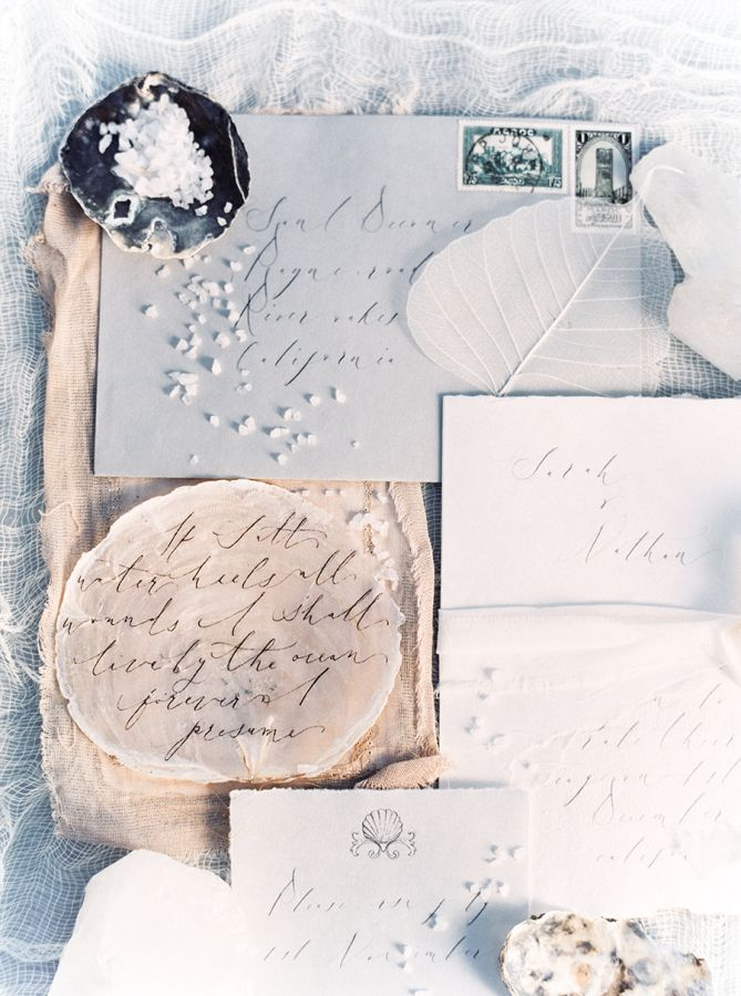 Winter coastal inspired invitations: http://www.stylemepretty.com/2016/01/19/coastal-winter-white-wedding-inspiration/ | Photography: Sally Pinera - http://sallypinera.com/