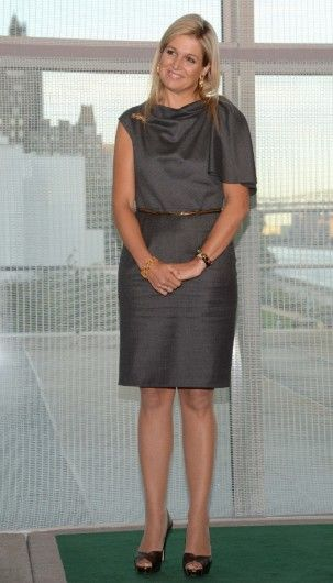 Máxima wears a grey dress and black heels. Click on the image to see more looks.