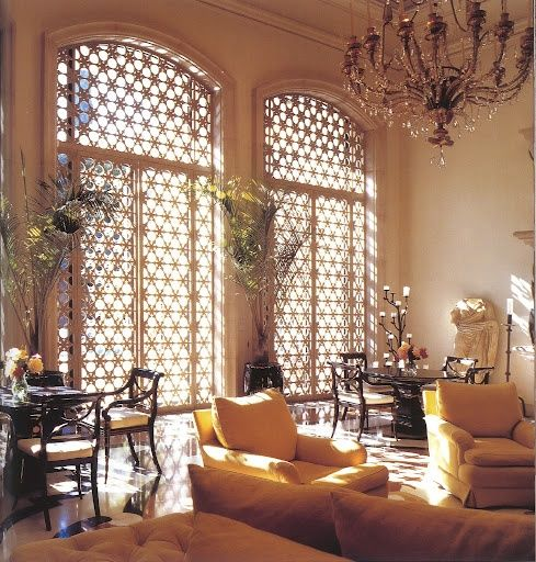Relaxing Moroccan Living Rooms. The lattices, the chandelier, the candlesticks...yet it's not too formal.