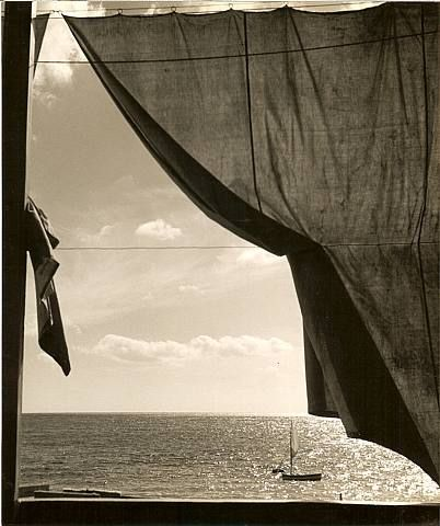 Herbert List, Looking Out To Sea http://thingsthatquickentheheart.blogspot.com/2011/04/black-white-windows-looking-in-looking.html