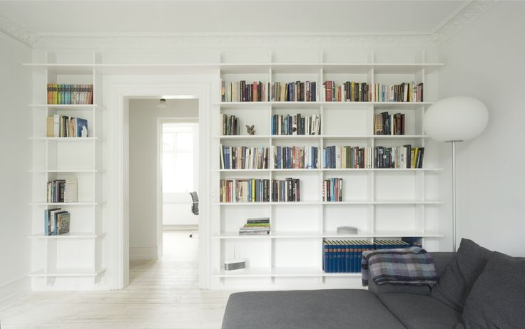 Custom made book shelf in a white laminate finish - from the Kildevældsgade Kitchen. Our furniture are always designed in close cooperation with the customer.