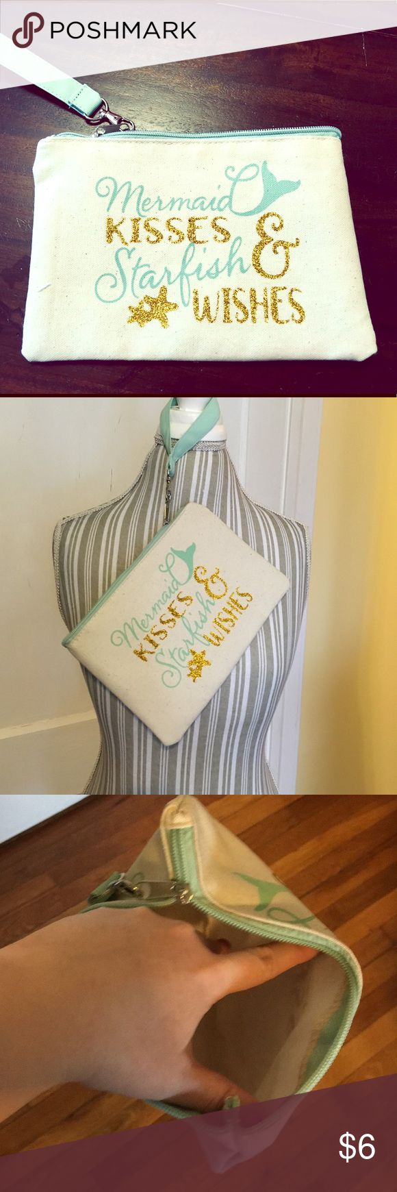 """NWOT Canvas """"Mermaid ♀️ Kisses"""" Cosmetics Bag Super cute canvas makeup bag or wristlet! White background for the body, aqua edging and detachable wristlet loop. Says """"Mermaid Kisses & Starfish Wishes"""" in aqua and gold cursive lettering.  - Smoke free home but we have pets. -Bundle 2 or more items for 20% off. Bags Cosmetic Bags & Cases"""