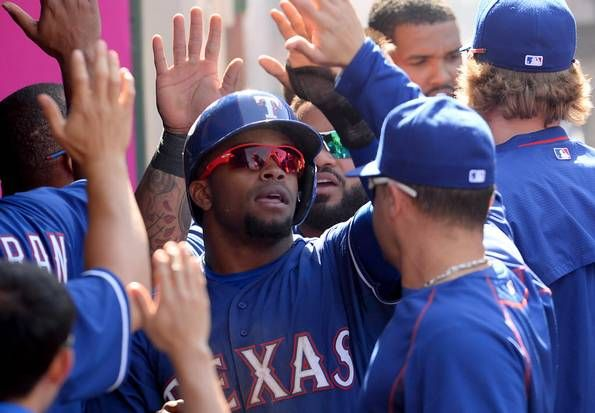 Apr 26, 2015; Anaheim, CA, USA; Texas Rangers left fielder Delino DeShields Jr. (7) in the dugout after scoring a run in the ninth inning of the game against the Los Angeles Angels at Angel Stadium of Anaheim. Rangers won 5-4. Mandatory Credit: Jayne Kamin-Oncea-USA TODAY Sports