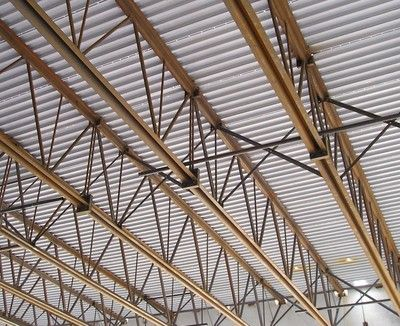 Steel roofing beams a large warehouse roof might be for Open web trusses
