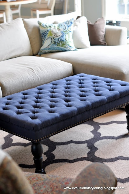 Colored ottoman to replace coffee table in family room?