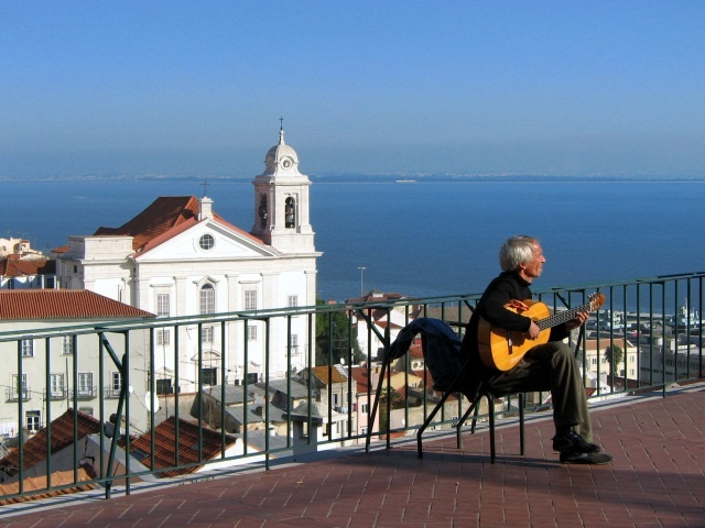 Fado Guitar player, landscape of Lisbon, Portugal