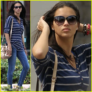 Adriana Lima stops to fix her hair while strolling around town on Monday (March 18) in Miami, Fla.
