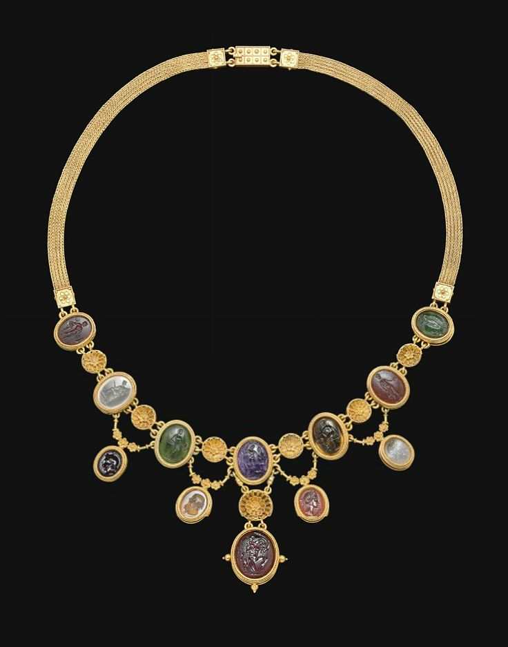 A NECKLACE OF TWELVE ROMAN RINGSTONES   CIRCA 1ST CENTURY B.C.-2ND CENTURY A.D.   Mounted together in a Victorian gold setting. [Cross posted from Ancient Jewelry]