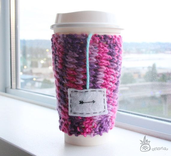 """An arrow can only be shot by pulling it backward. So when life is dragging you back with difficulties, it means that it's going to launch you into something great."" – Unknown // Knitted Pink and Purple Travel Mug Cozy with Felt by OnanaKnits, $15.75 // Find out more at our Etsy store! OnanaKnits.etsy.com #knitting #cosy #cozy #mugcozies #cupcozy #onanaknits #coffeesleeves #coffee #tea #handmade"