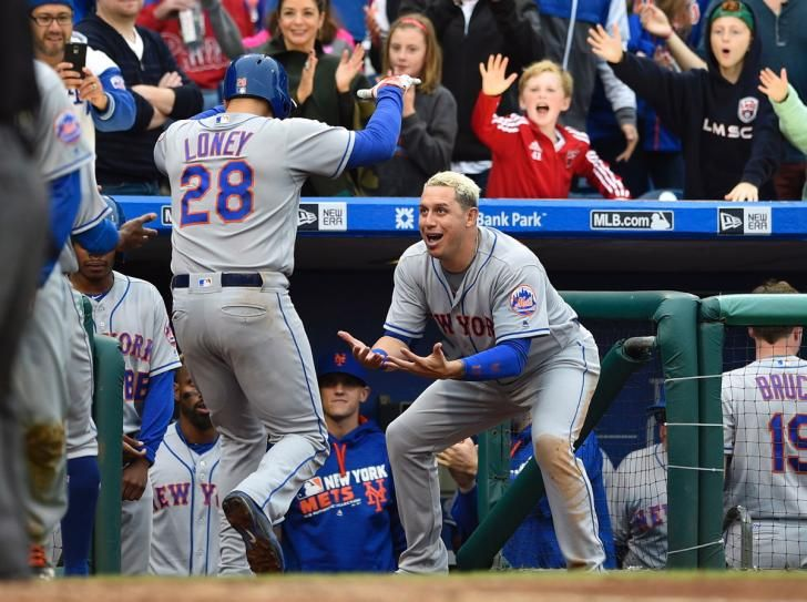 New York Mets first baseman James Loney (28) is greeted at the dugout by  Asdrubal Cabrera (13) after hitting a two-run home run during the sixth inning against the Philadelphia Phillies at Citizens Bank Park.