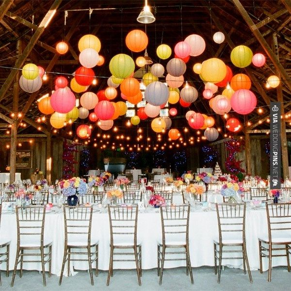 lanterns in a barn with string lights