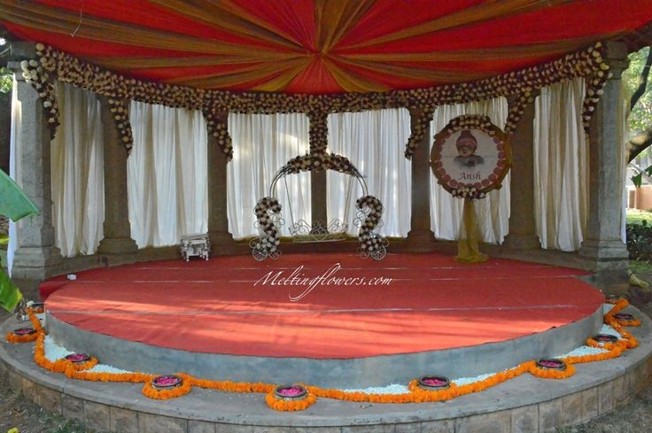 Naming ceremony decoration in bangalore by melting flowers for Baby name ceremony decoration ideas