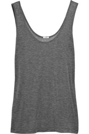 Grey tank top. Comfy. Can be dressed up or down. Buy one that is beautifully soft to touch and well made.