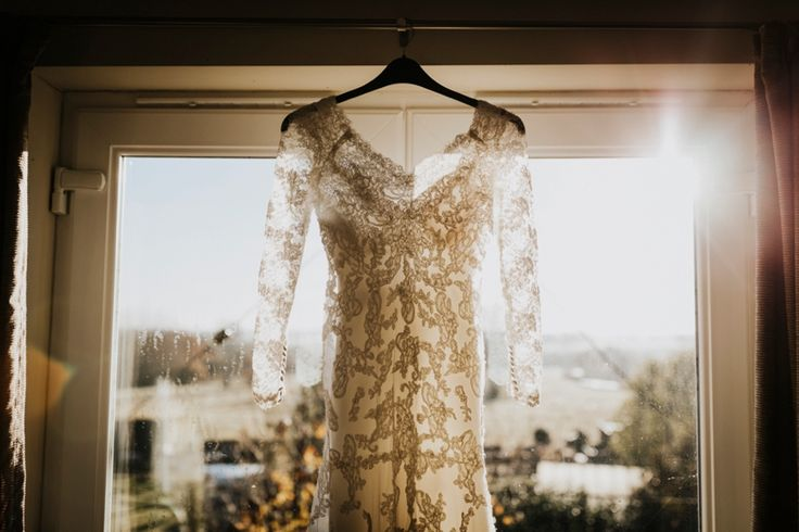 Such a fan of these gorgeous lace sleeves. Photo by Benjamin Stuart Photography #weddingphotography #weddingdress #lacedress #sleeves #bride #weddingday #sunshine #bridalprep