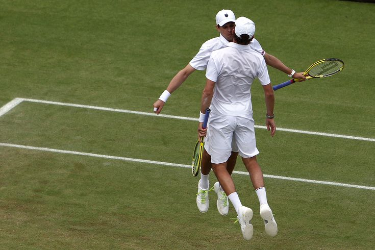 Bob and Mike Bryan celebrate after defeating Michael Llodra and Aarnaud Clement in the third round #Wimbeldon