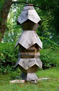 information about visionary beekeeper Ron Breland's dodecahedron hive.  artwork in the apiary