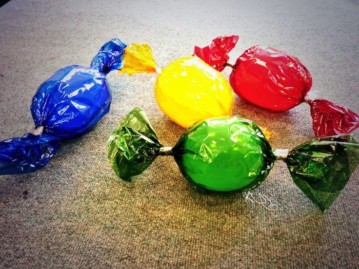 Giant Sweets: I used these to decorate my classroom on my recent Charlie and the Chocolate Factory day. They were quick and easy to make - simply wrap a balloon in coloured cellophane!