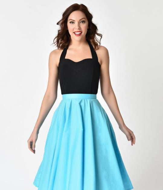 Cut to be courteous to your curves, this cotton blend stretch top is fashioned in solid black and goes with all the swing skirts and cigarette pants in your retro inspired closet! The sweetheart neckline boasts a flirty deep V design in the center, and se