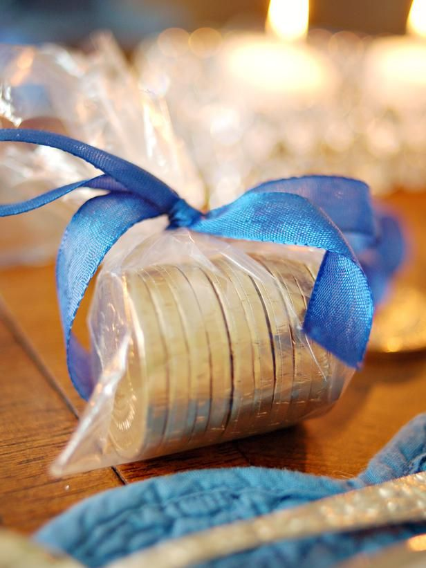 A Sweet Party Favor ~ Wrap Hanukkah gelt in a zippered bag with the top cut off. Tie closed with a blue ribbon and set at each place as a small gift for guests to enjoy after dinner or take home.