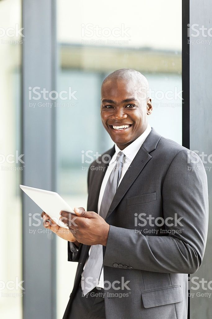 african american entrepreneur using tablet computer royalty-free stock photo