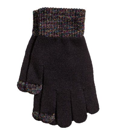 Black/glittery. Fine-knit gloves with ribbed cuffs. Top of thumb and index finger in smartphone-compatible material.