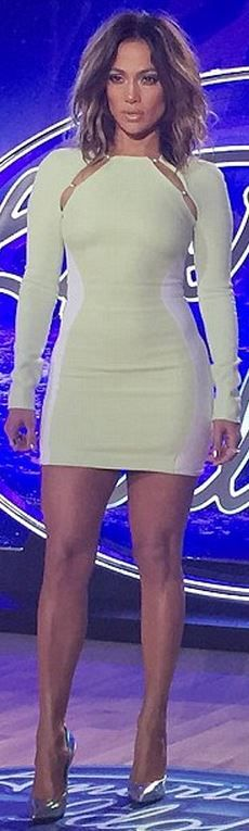 Who made  Jennifer Lopez's silver pumps and white cut out dress?