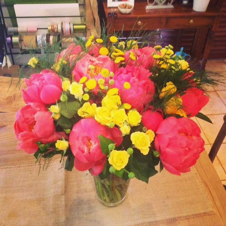 Coral peonies and yellow rose bouquet