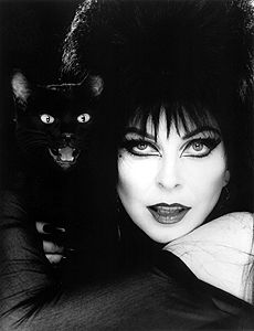 Elvira... I think she'll be in a nice silver frame on a bedside table. When guests go in to add their coats to the pile, she'll be a nice sight.