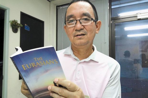 First book: Peter showing his debut novel 'The Eurasians'.