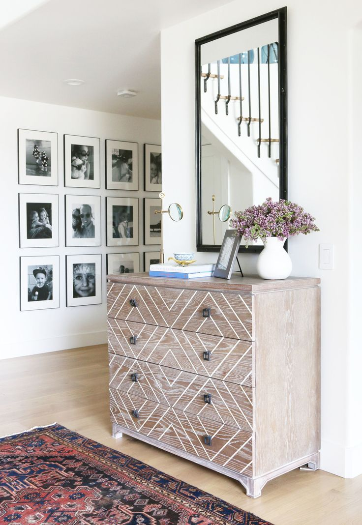Persian rug and gallery wall in  the entry || Studio McGee House described as warm, fresh and modern.