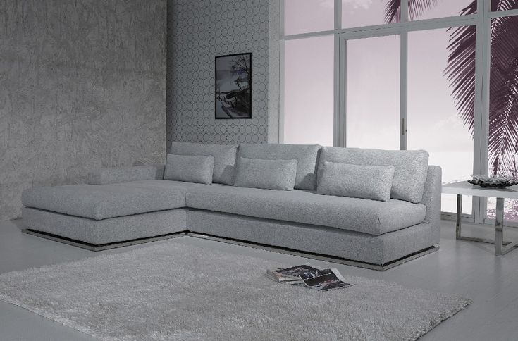 Light grey contemporary L shape fabric sectional sofa. When you are looking for extreme comfort and a great design this sectional is the perfect attribute you are looking for in your new living room interior.