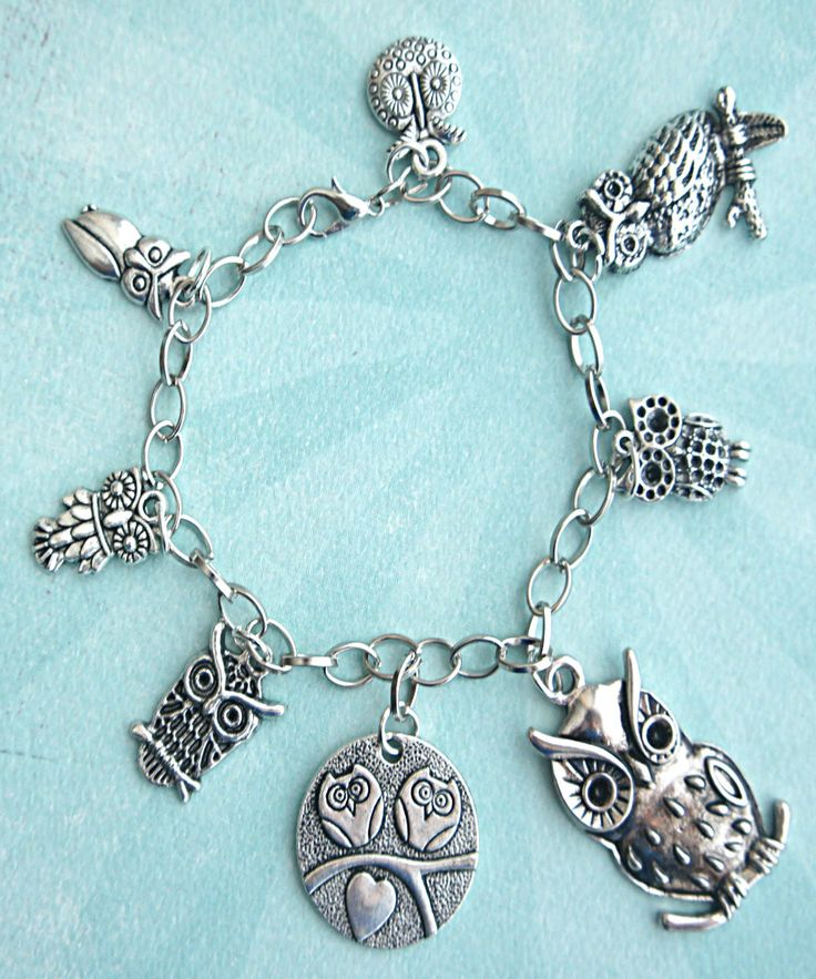 this charm bracelet features owl Tibetan silver charms (nickel free). the charms are attached to a silver tone 7.5 inches chain bracelet.