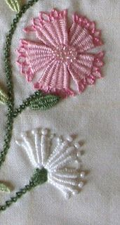 Embroidary: Needleweaving (never heard of it), woven picot leaves, and raised chain band stems.